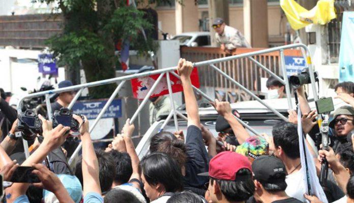 Activists in Bangkok Throw Paint at Cops