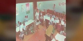 Teacher pushing kid to the floor