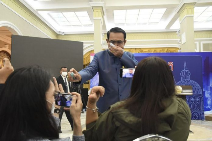 Prime Minister Sprays reporters
